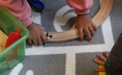 Children play with wooden track